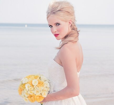 blonde bride holding yellow bouquet