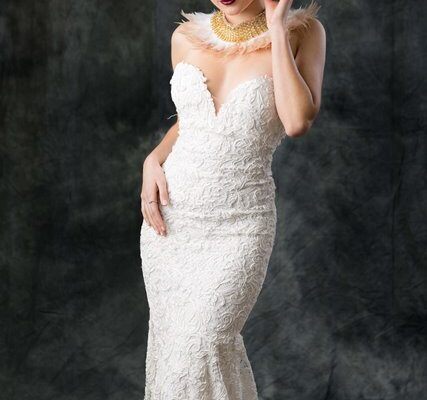 bride posing with wedding dress on