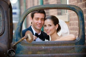 bride and groom in an old car